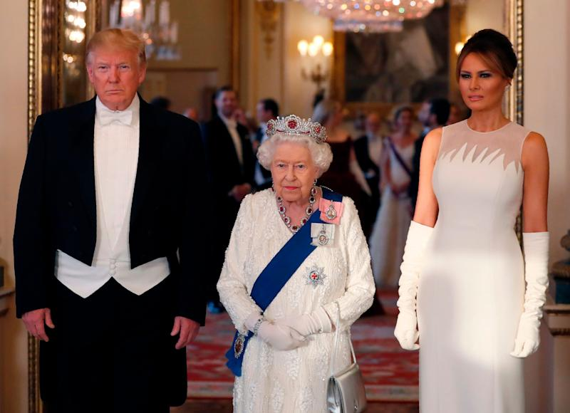 Queen Elizabeth II, President Donald Trump and first lady Melania Trump pose for a photograph ahead of a state banquet in the ballroom at Buckingham Palace on June 3, 2019, the first day of the Trumps' three-day visit to the U.K.