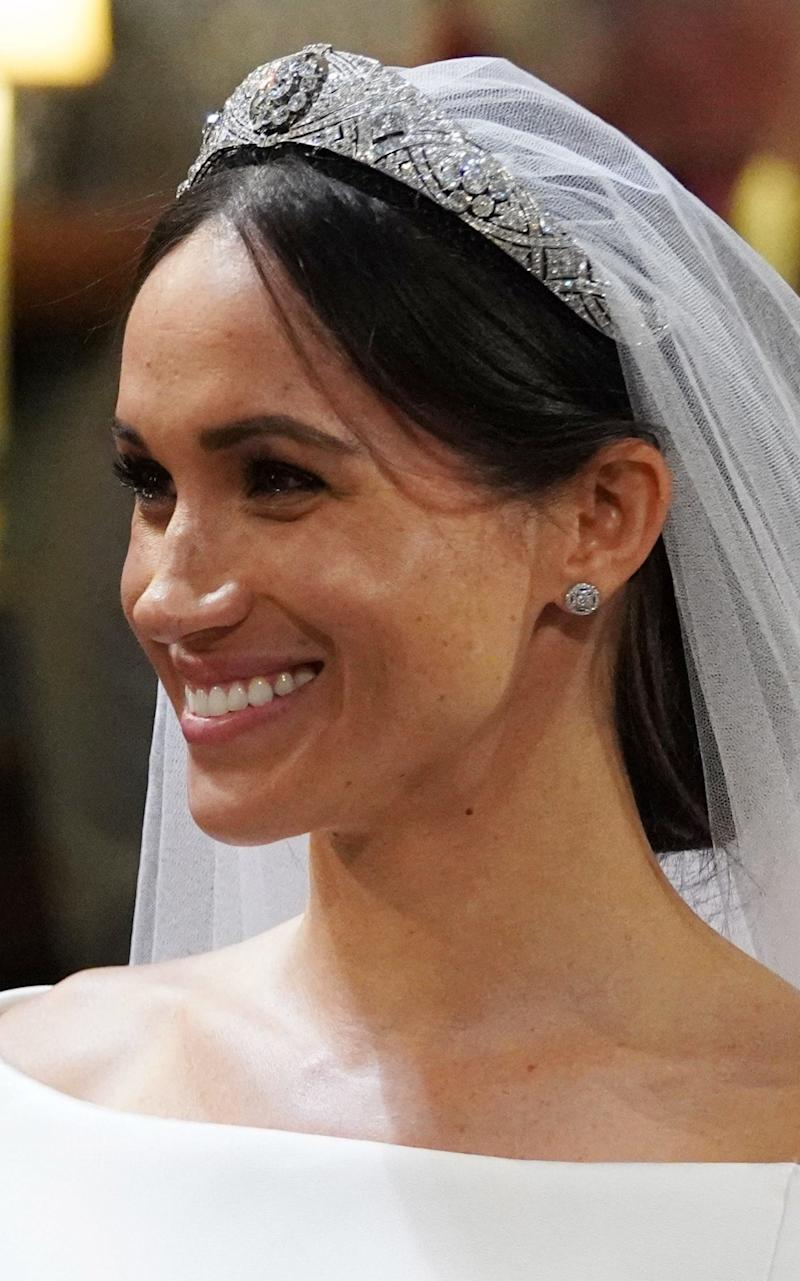 Meghan Markle wearing the Queen Mary diamond bandeau tiara and Cartier earrings - PA