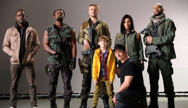 Rhodes with the cast of 'The Predator.'