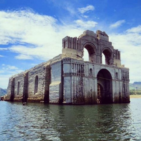 """<p>A drought in southern Mexico has caused water levels surrounding this <a href=""""http://www.huffingtonpost.com/entry/temple-of-santiago-mexico_56244bcae4b02f6a900cc670"""" rel=""""nofollow noopener"""" target=""""_blank"""" data-ylk=""""slk:450-year-old church"""" class=""""link rapid-noclick-resp"""">450-year-old church</a> to drop approximately 80 feet. Though the circumstances aren't exactly something to celebrate, they've allowed <a href=""""https://instagram.com/p/6kbJopy1Rd/"""" rel=""""nofollow noopener"""" target=""""_blank"""" data-ylk=""""slk:the temple"""" class=""""link rapid-noclick-resp"""">the temple</a> that's usually hidden below the water to emerge—a stunning-yet-eerie reminder of how things are not always what they seem. </p>"""