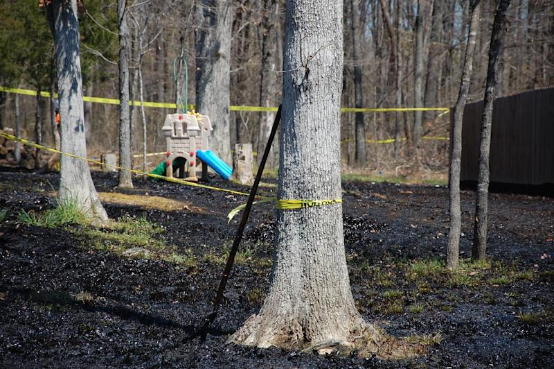 Oil covers the ground around a slide in Mayflower, Ark., on Monday, April 1, 2013, days after a pipeline ruptured and spewed oil over lawns and roadways. (AP Photo/Jeannie Nuss)