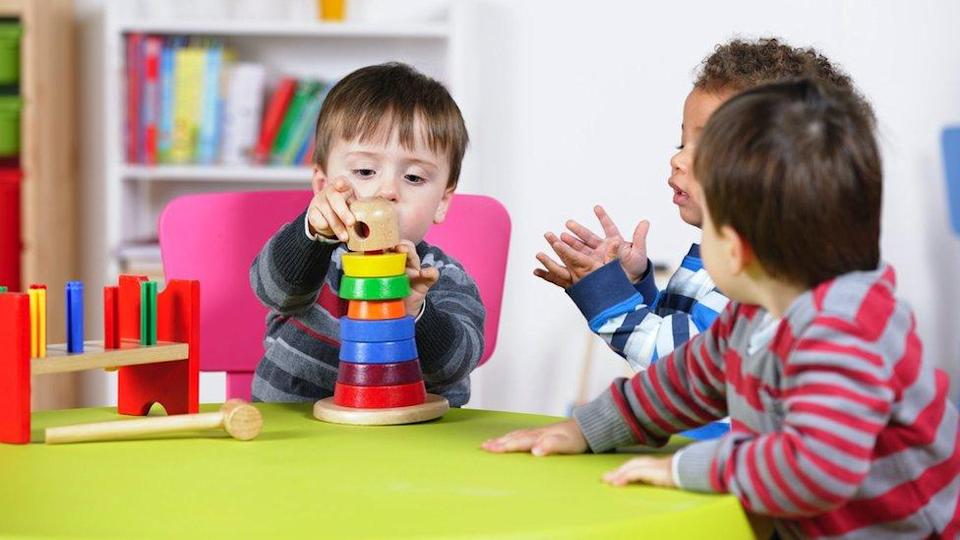 A group of boys playing with educational toys; stock photo