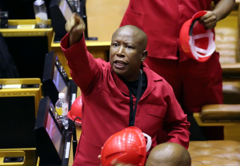 Opposition Economic Freedom Fighters party leader Julius Malema objects as South African President Cyril Ramaphosa attempts to deliver his State of the Nation address at parliament in Cape Town