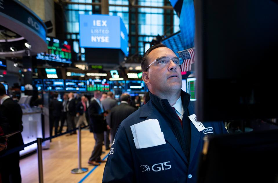 A trader works ahead the opening bell at the New York Stock Exchange (NYSE) on June 18, 2019 located at Wall Street in New York City. (Photo by Johannes EISELE / AFP)        (Photo credit should read JOHANNES EISELE/AFP/Getty Images)