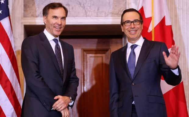 Steven Mnuchin, right, treasury secretary in the Trump administration, and Bill Morneau, who served as Canada's finance minister from 2015 to 2020, were said to have had a good relationship despite tension between Trump and Trudeau.