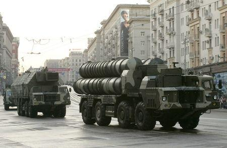 FILE PHOTO: Russian military vehicles move along a central street during a rehearsal for a military parade in Moscow