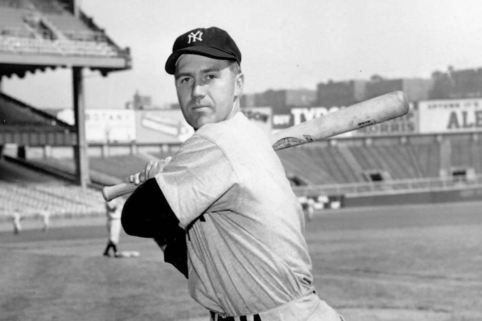 FILE - New York Yankees third baseman Bobby Brown poses at Yankee Stadium in New York, in this Oct. 2, 1950, file photo. Bobby Brown, who won five World Series as an infielder with the New York Yankees and later became president of the American League, has died at age 96. The Yankees said that Brown died on Thursday morning, March 25, 2021, in Fort Worth, Texas. (AP Photo/File)
