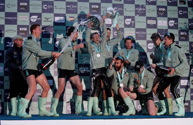 Rowing - 2018 Oxford University vs Cambridge University Boat Race - London, Britain - March 24, 2018 Cambridge celebrate with the trophy after victory in the men's boat race REUTERS/Matthew Childs
