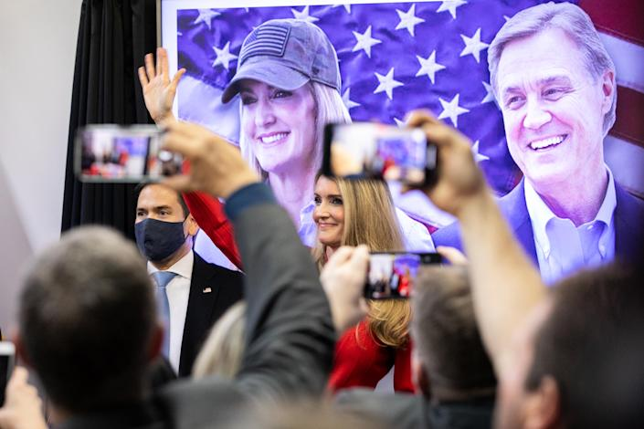 Republican U.S. Senate candidate Kelly Loeffler waves to the crowd with Senator Marco Rubio (R-FL) during a Save Our Majority campaign rally on November 11, 2020. (Photo by Jessica McGowan/Getty Images)