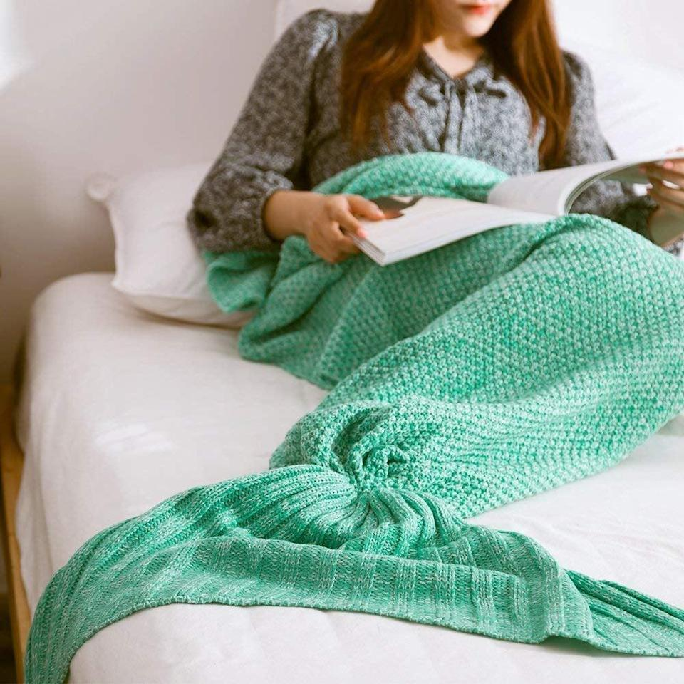 <p>Stay cozy with this <span>Mermaid Knitted Blanket</span> ($20), which comes in a few different colors.</p>