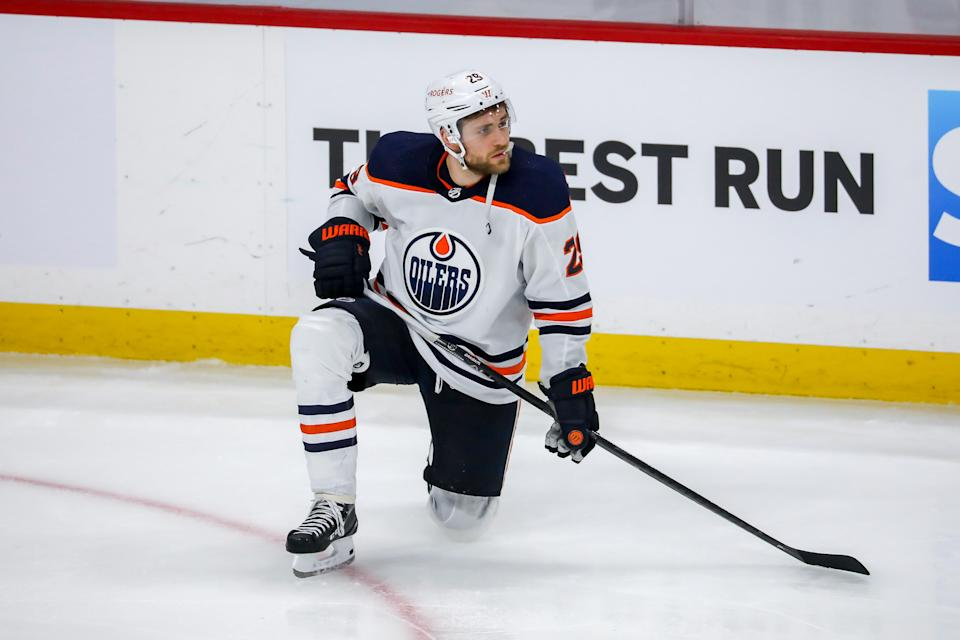 WINNIPEG, MB - MAY 24: Leon Draisaitl #29 of the Edmonton Oilers kneels dejectedly on the ice following a 4-3 triple overtime loss against the Winnipeg Jets in Game Four of the First Round of the 2021 Stanley Cup Playoffs at the Bell MTS Place on May 24, 2021 in Winnipeg, Manitoba, Canada. The Jets sweep the series 4-0. (Photo by Jonathan Kozub/NHLI via Getty Images)