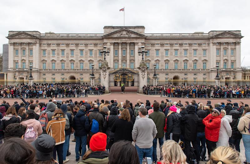 General view of crowds outside Buckingham Palace, London, ahead of the Changing of the Guard ceremony as the Government's top scientist warned that up to 10,000 people in the UK are already infected with Covid-19. (Photo by Dominic Lipinski/PA Images via Getty Images)