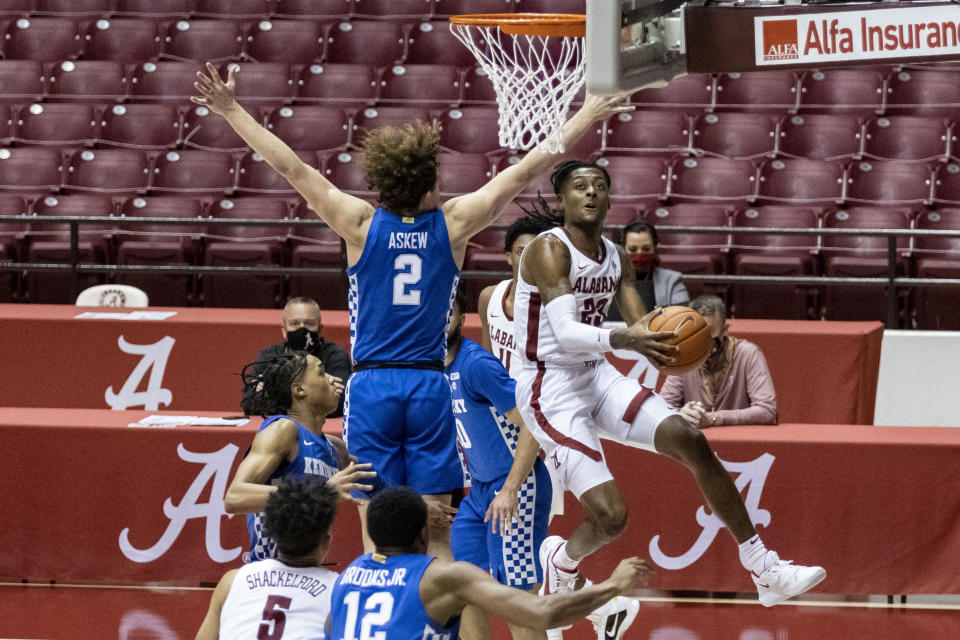 Alabama guard John Petty Jr. (23) works by Kentucky guard Devin Askew (2) for a shot during the second half of an NCAA college basketball game, Tuesday, Jan. 26, 2021, in Tuscaloosa, Ala. (AP Photo/Vasha Hunt)