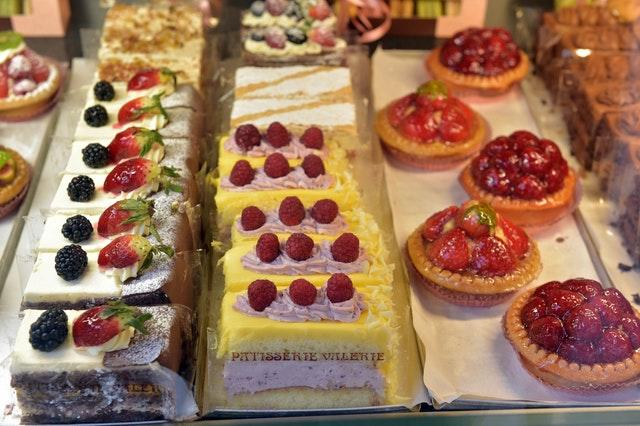 Patisserie Valerie cakes on display in a shop window