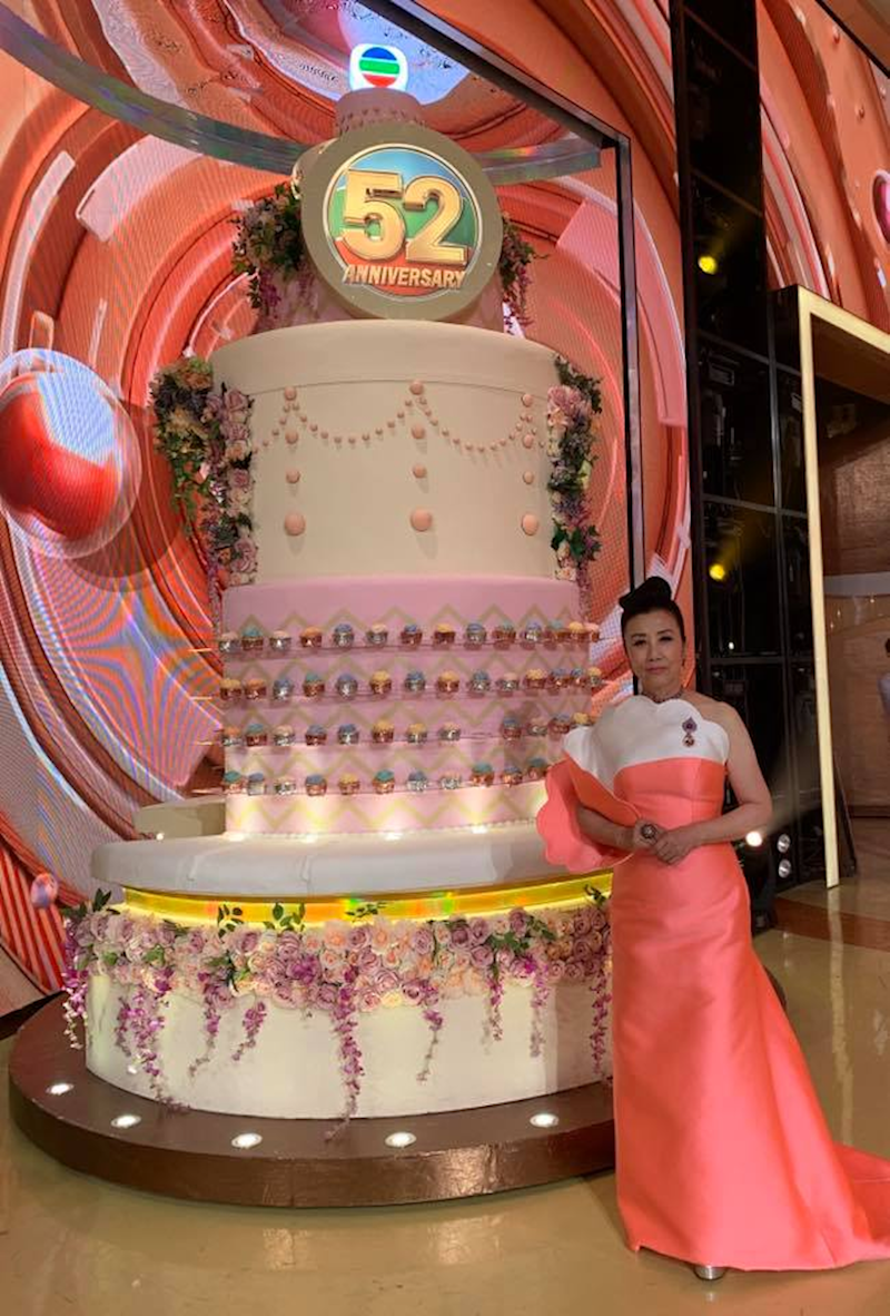 Co-host of the programme Hong Kong actress and singer Liza Wang with the anniversary cake in conjunction with TVB's 52nd anniversary celebration. — Facebook/ Lizawangliza