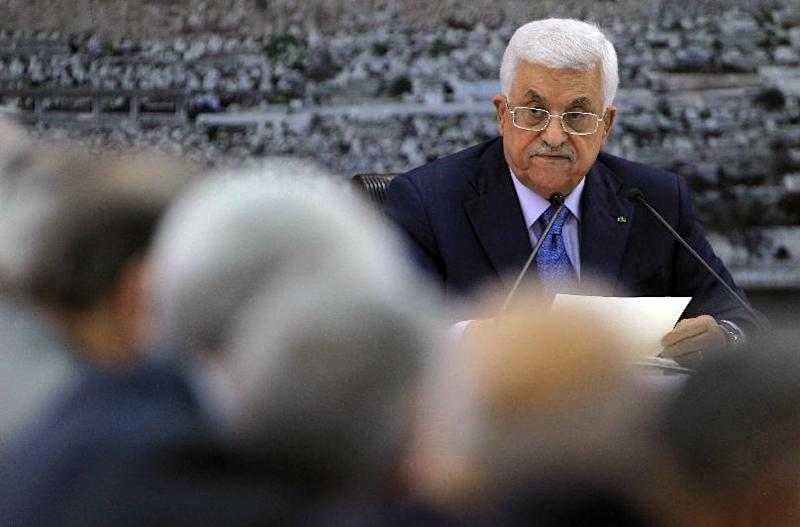 Palestinian Authority President Mahmoud Abbas adresses journalists as he meets with members of the Palestine Liberation Organization on July 22, 2014 in the West Bank city of Ramallah (AFP Photo/Abbas Momani)