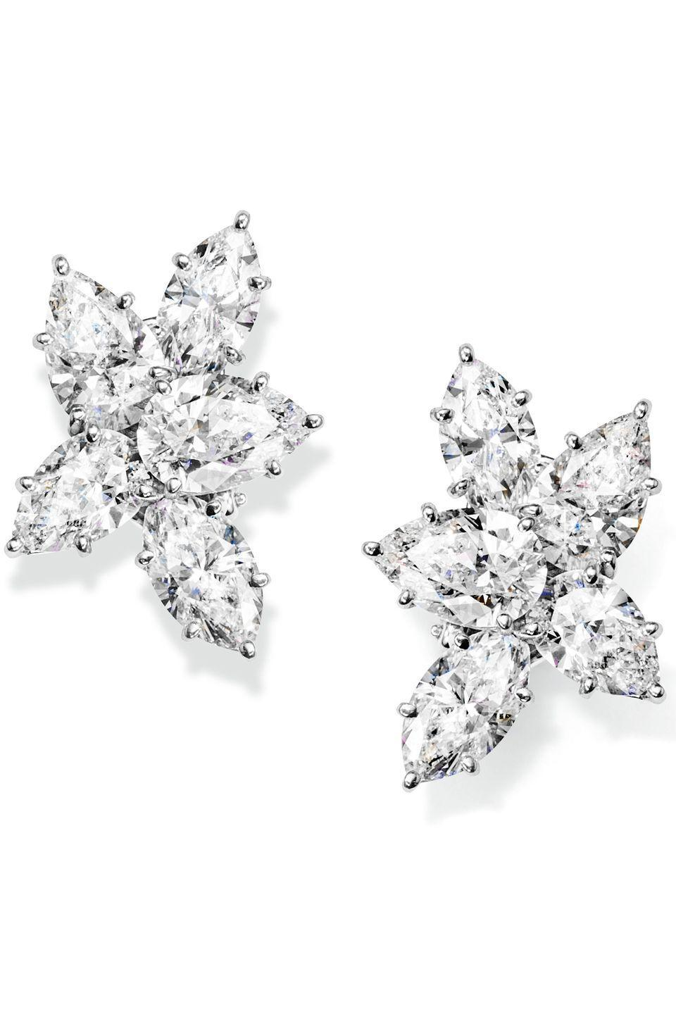 """<p><a class=""""link rapid-noclick-resp"""" href=""""https://www.harrywinston.com/en/winston%E2%84%A2-cluster-harry-winston-large-diamond-earrings"""" rel=""""nofollow noopener"""" target=""""_blank"""" data-ylk=""""slk:SHOP NOW"""">SHOP NOW</a></p><p>The American jeweller, Harry Winston, founded his eponymous house in 1932 and became renowned for handling some of the world's most famous diamonds. </p><p>As the 'King of Diamonds', he was the first jeweller to lend diamonds to an actress (Jennifer Jones, who was nominated for her role in the film Songs of Bernadette) for the Academy Awards in 1944. His sparkle has been spotted on red carpets around the world ever since. Marylin Monroe even mentions him in her song Diamonds Are a Girl's Best Friend, from the film Gentlemen Prefer Blondes. </p><p>Winston's signature technique came about in the 1940s, when he combined pear and marquise-cut diamonds at varying angles to create 'clusters' of brilliants. The cluster remains a trademark of the jeweller to this day, and aficionados adore it for its intense sparkle - as seen on A-listers like Jennifer Lopez, Charlize Theron, Margot Robbie, Helen Mirren and Natalie Portman. </p><p>White diamond and platinum earrings, price on request, <a href=""""https://www.harrywinston.com/en"""" rel=""""nofollow noopener"""" target=""""_blank"""" data-ylk=""""slk:Harry Winston"""" class=""""link rapid-noclick-resp"""">Harry Winston</a></p>"""
