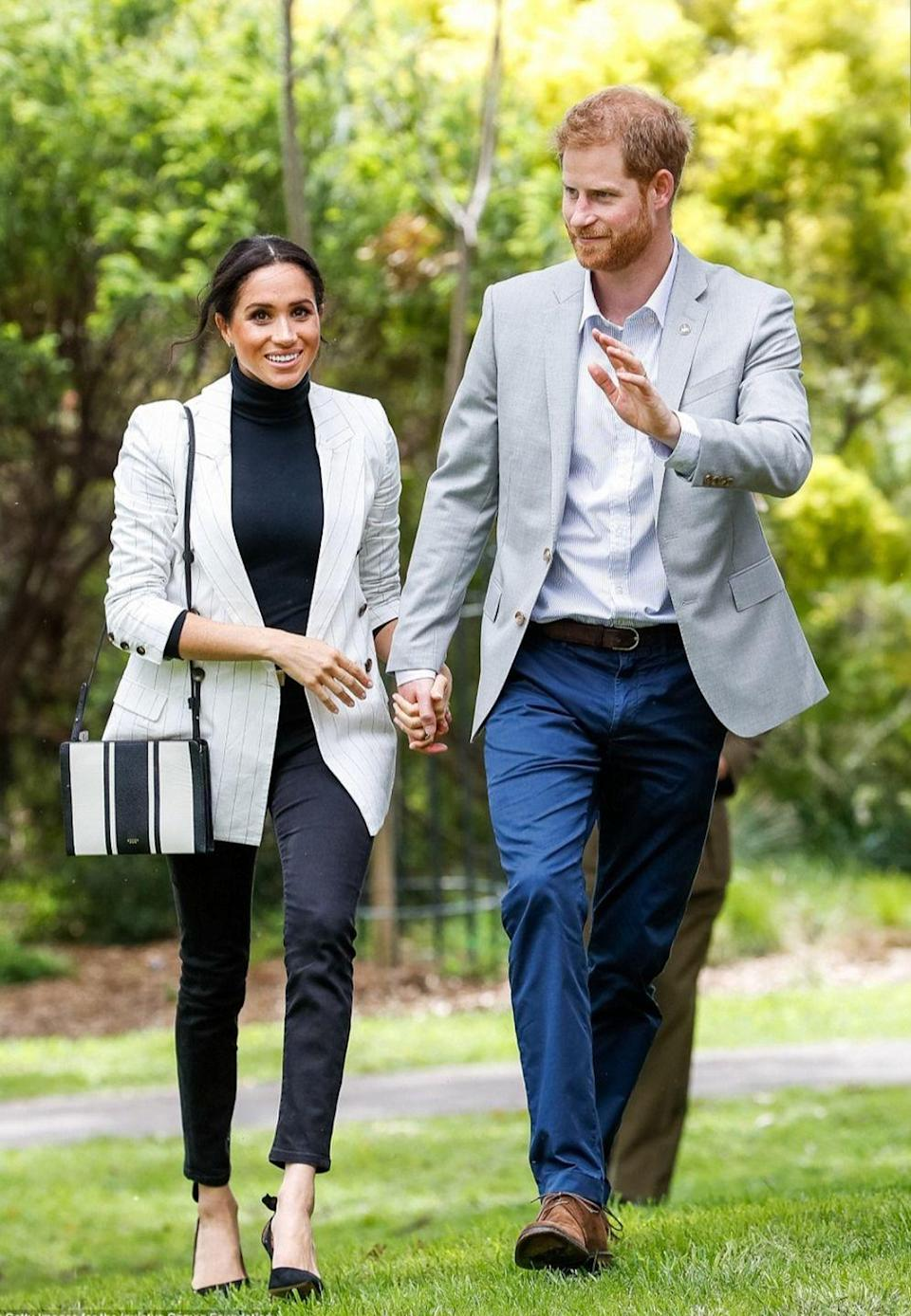 """<p>On Sunday, Meghan and Harry <a href=""""https://www.townandcountrymag.com/society/tradition/g23940939/meghan-markle-prince-harry-invictus-games-sydney-2018-royal-tour-photo-day-6/"""" rel=""""nofollow noopener"""" target=""""_blank"""" data-ylk=""""slk:attended a reception hosted by the Prime Minister"""" class=""""link rapid-noclick-resp"""">attended a reception hosted by the Prime Minister</a> of Australia. The Duchess wore a blazer by L'Agence with a black turtle neck and black jeans by <a href=""""https://outlanddenim.com/products/harriet-in-black"""" rel=""""nofollow noopener"""" target=""""_blank"""" data-ylk=""""slk:Outland Denim"""" class=""""link rapid-noclick-resp"""">Outland Denim</a> for the event. She accessorized with Aquazzura Deneuve Pumps and a crossbody bag by Oroton.<br></p><p><a class=""""link rapid-noclick-resp"""" href=""""https://go.redirectingat.com?id=74968X1596630&url=https%3A%2F%2Fwww.harveynichols.com%2Fint%2Fbrand%2Faquazzurra-kids%2F273504-deneuve-black-suede-pumps%2Fp3169415%2F&sref=https%3A%2F%2Fwww.townandcountrymag.com%2Fstyle%2Ffashion-trends%2Fg3272%2Fmeghan-markle-preppy-style%2F"""" rel=""""nofollow noopener"""" target=""""_blank"""" data-ylk=""""slk:SHOP NOW"""">SHOP NOW</a> <em>Aquazzura Deneuve Pumps, $550.69</em></p>"""
