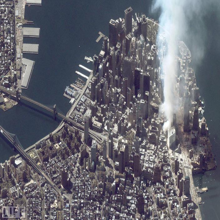 """A satellite image of lower Manhattan shows smoke and ash rising from the site of the World Trade Center at 11:43 AM on September 12, 2001. The fires at Ground Zero continued to burn for 99 days after the attack -- a bleak reminder, day and night, of the thousands who lost their lives, and the countless millions more who lived, but whose lives were forever transformed. <br><br>(Photo: Getty Images)<br><br>For the full photo collection, go to <a href=""""http://www.life.com/gallery/59971/911-the-25-most-powerful-photos#index/0"""" rel=""""nofollow noopener"""" target=""""_blank"""" data-ylk=""""slk:LIFE.com"""" class=""""link rapid-noclick-resp"""">LIFE.com</a>"""
