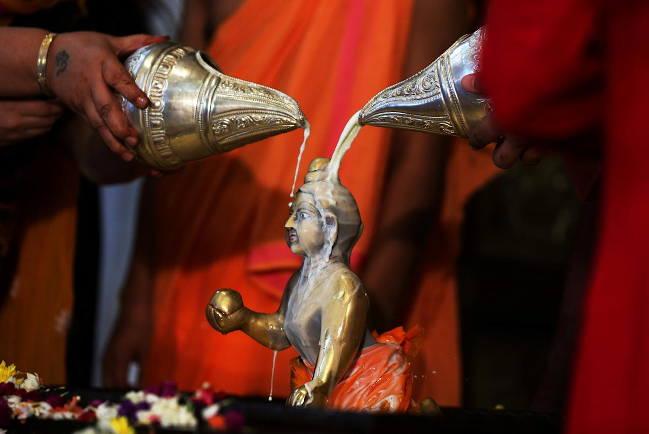 <p>Hindu devotees pour milk over the idol of Hindu Lord Krishna during the festival of Janmashtami, marking the birth anniversary of Lord Krishna, in Ahmedabad, India, September 3, 2018. REUTERS/Amit Dave TPX IMAGES OF THE DAY </p>