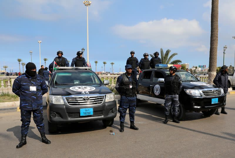 Security forces stand guard during a celebration of the 9th anniversary of the revolution against former Libyan leader Muammar Gaddafi at Martyrs' Square in Tripoli