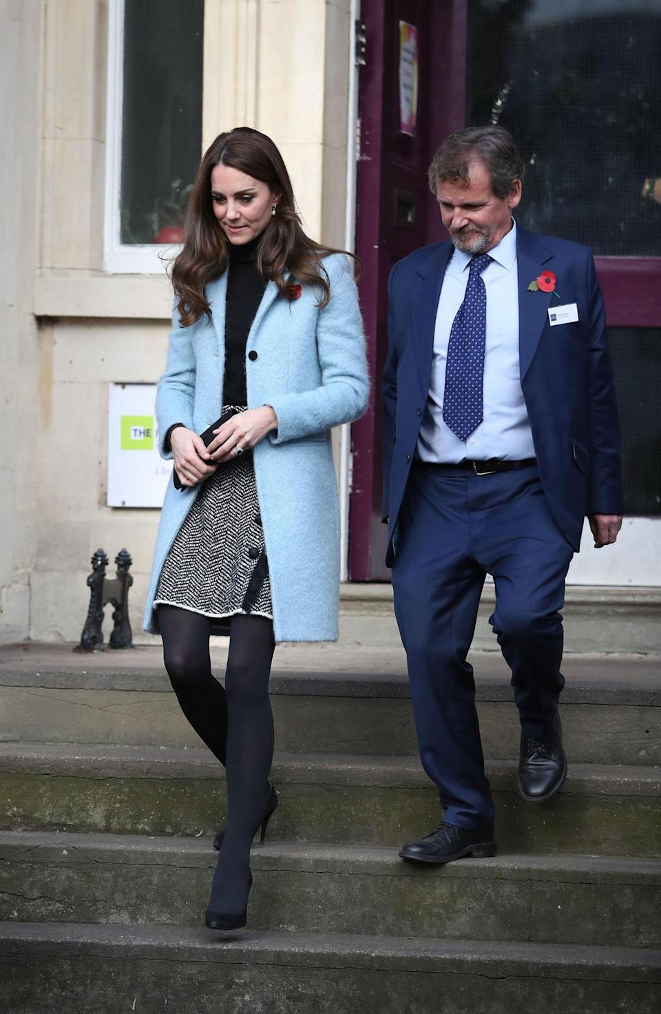<p>On a visit to a women's centre, the Duchess proved that it's definitely time to start wearing tights. Wrapping up in a duck egg blue coat by Mulberry, she paired the cosy look with a printed Dolce & Gabbana skirt and simple black turtleneck. </p><p><i>[Photo: PA]</i></p>