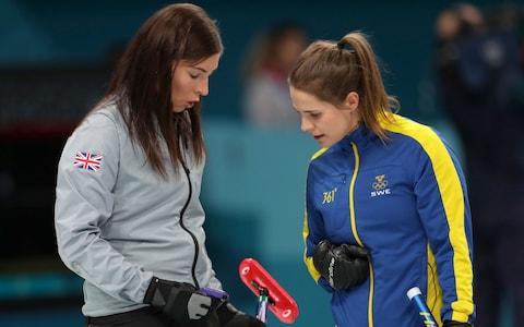 Great Britain skipper Eve Muirhead (left) exchanges words with Sweden Skipper Anna Hasselborg - Credit: Mike Egerton/PA Wire