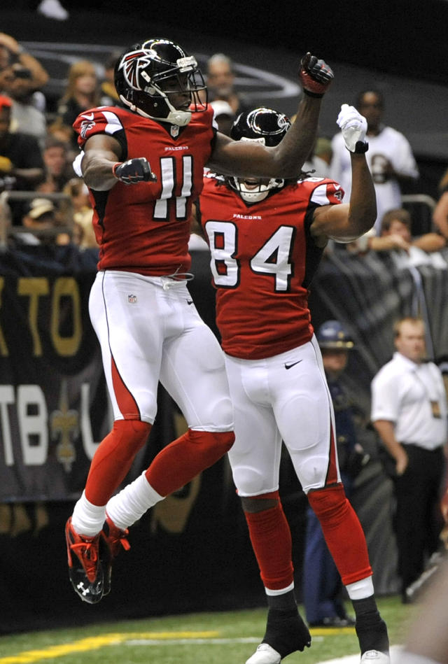 Atlanta Falcons wide receiver Julio Jones (11) celebrates his touchdown reception with wide receiver Roddy White (84) in the second half of an NFL football game against the New Orleans Saints in New Orleans, Sunday, Sept. 8, 2013. (AP Photo/Bill Feig)