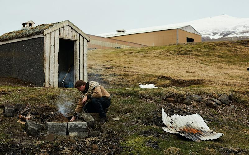 Guðmundur Sigurjónsson on his sheep farm, outside the traditional smokehouse - Credit: Laura Edwards