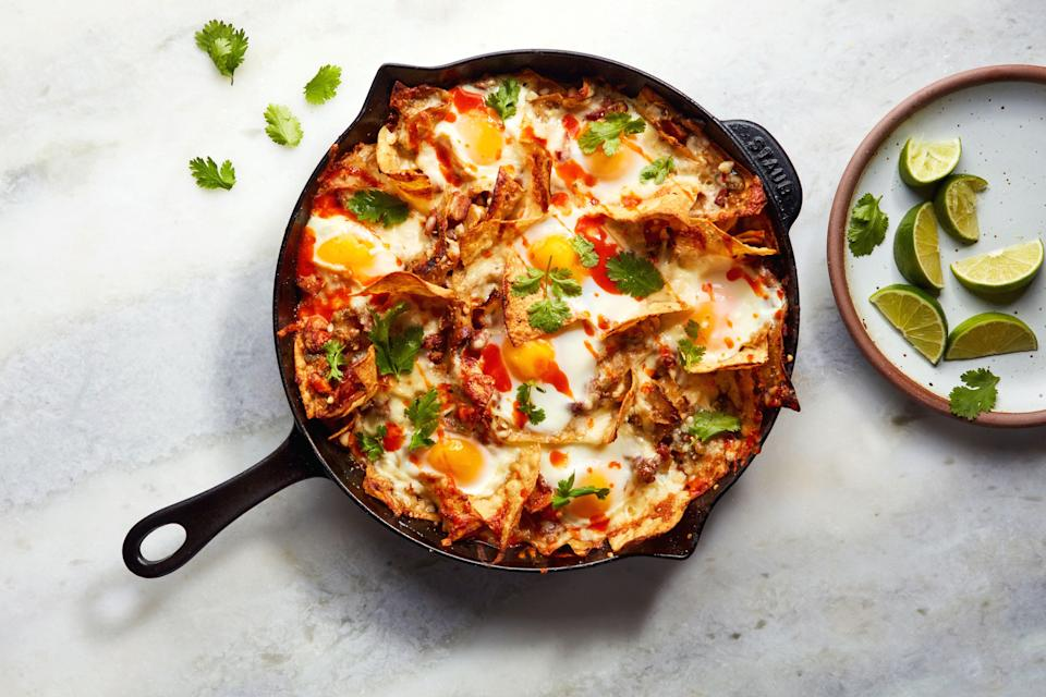 """This is one of those eggy, bacon-packed recipes that would satisfy anyone at the table for breakfast, lunch, dinner, or anytime in between. <a href=""""https://www.epicurious.com/recipes/food/views/chilaquiles-with-bacon-eggs-and-cheese?mbid=synd_yahoo_rss"""" rel=""""nofollow noopener"""" target=""""_blank"""" data-ylk=""""slk:See recipe."""" class=""""link rapid-noclick-resp"""">See recipe.</a>"""