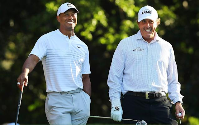 "<a class=""link rapid-noclick-resp"" href=""/pga/players/147/"" data-ylk=""slk:Tiger Woods"">Tiger Woods</a> and Phil Mickelson - AP"