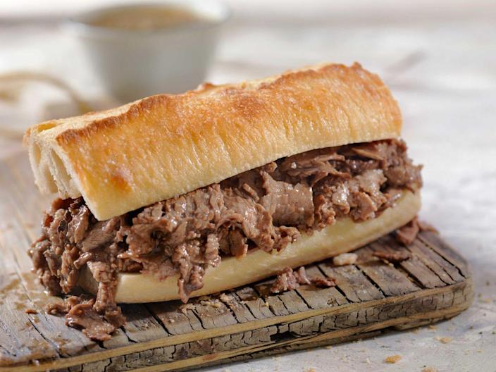 """<p><strong>French Dip</strong></p><p>Step aside avocado toast -- the French Dip was invented in Los Angeles, specifically at this 100-year-old restaurant, <a href=""""https://www.philippes.com/"""" rel=""""nofollow noopener"""" target=""""_blank"""" data-ylk=""""slk:Philippe the Original"""" class=""""link rapid-noclick-resp"""">Philippe the Original</a>. The Beef Double-Dip is a can't miss on the menu, where both slices of bread are dipped in jus before adding tender roast beef. </p>"""