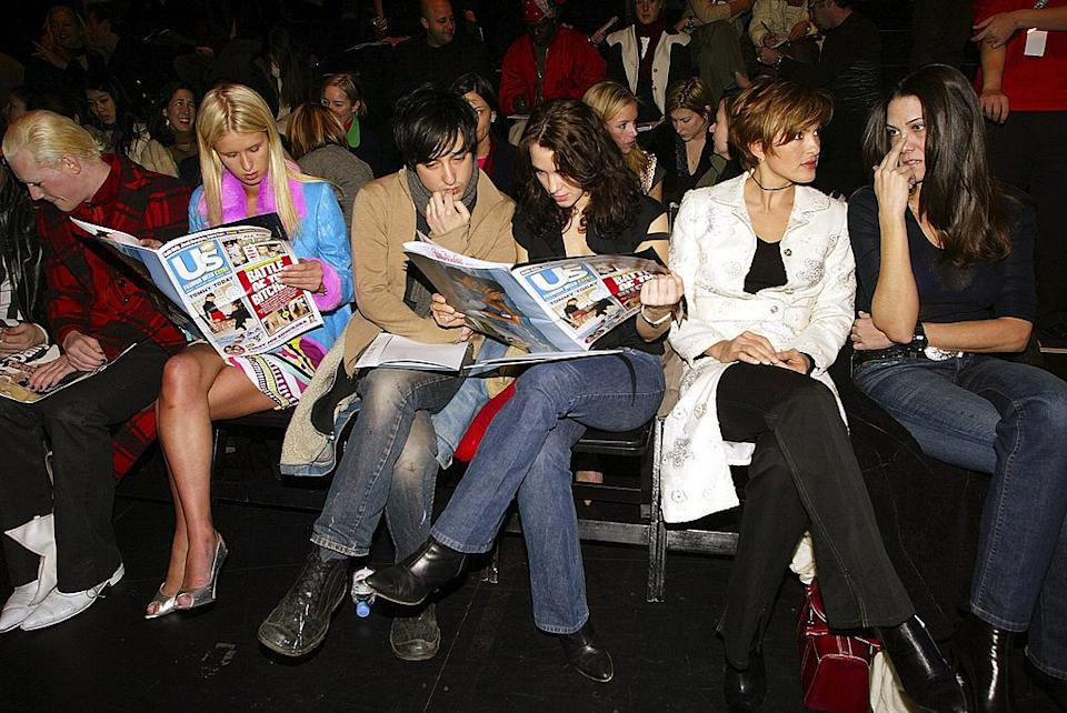 <p>Back in 2003, the front row was a little less glam than what we're used to seeing these days. Distressed denim was the clothing of choice and issues of <i>Us Weekly</i> kept famous faces Nicky Hilton and Mariska Hargitay entertained pre-show. <i>(Scott Gries/Getty Images)</i></p>