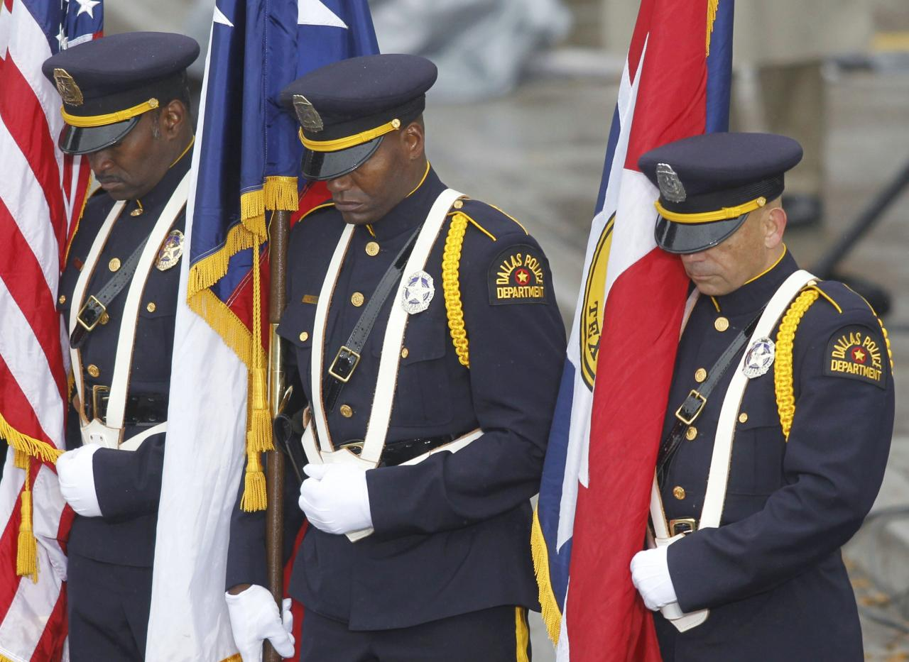 Members of a Dallas Police Department honor guard stand during the invocation in Dealey Plaza during ceremonies marking the 50th anniversary of the assassination of President John F. Kennedy in Dallas, Texas November 22, 2013. REUTERS/Mike Stone (UNITED STATES - Tags: POLITICS ANNIVERSARY MILITARY)