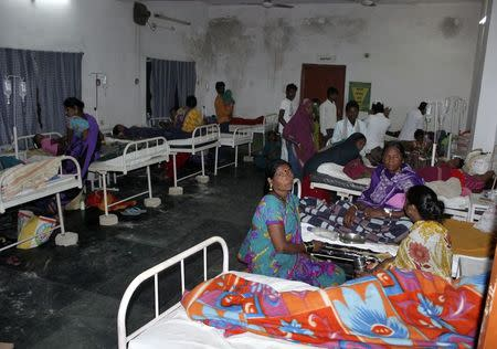 "Women who underwent botched sterilization surgeries at a government mass sterilization ""camp"" receive treatment at a district hospital in Bilaspur, in Chhattisgarh, November 10, 2014. REUTERS/Stringer"