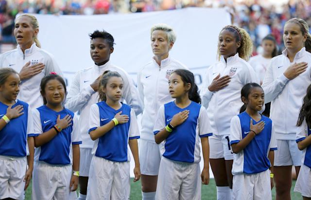 Megan Rapinoe stands during the national anthem, but she refuses to put her hand over her heart. (AP)