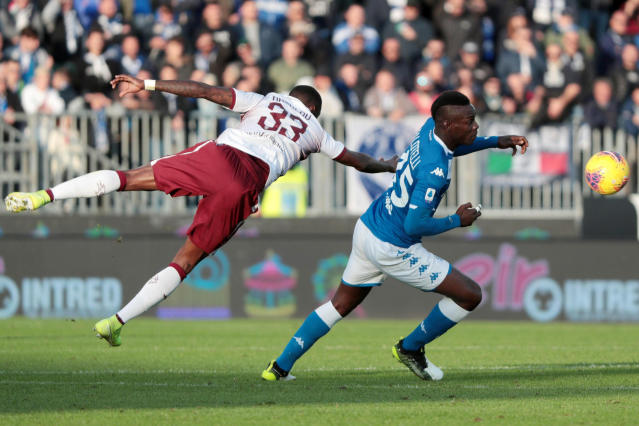 Brescia's Mario Balotelli and Torino's Nicolas N'Koulou, left, go for the ball during the Serie A soccer match between Brescia and Torino at the Mario Rigamonti Stadium in Brescia, Italy, Saturday, Nov. 9, 2019. (Filippo Venezia/ANSA via AP)