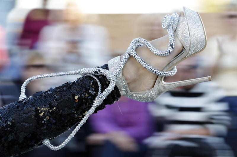 Miss Mississippi Chelsea Rick displays her shoe during the Miss America Shoe Parade at the Atlantic City boardwalk, Saturday, Sept. 14, 2013, in Atlantic City, N.J. (AP Photo/Julio Cortez)