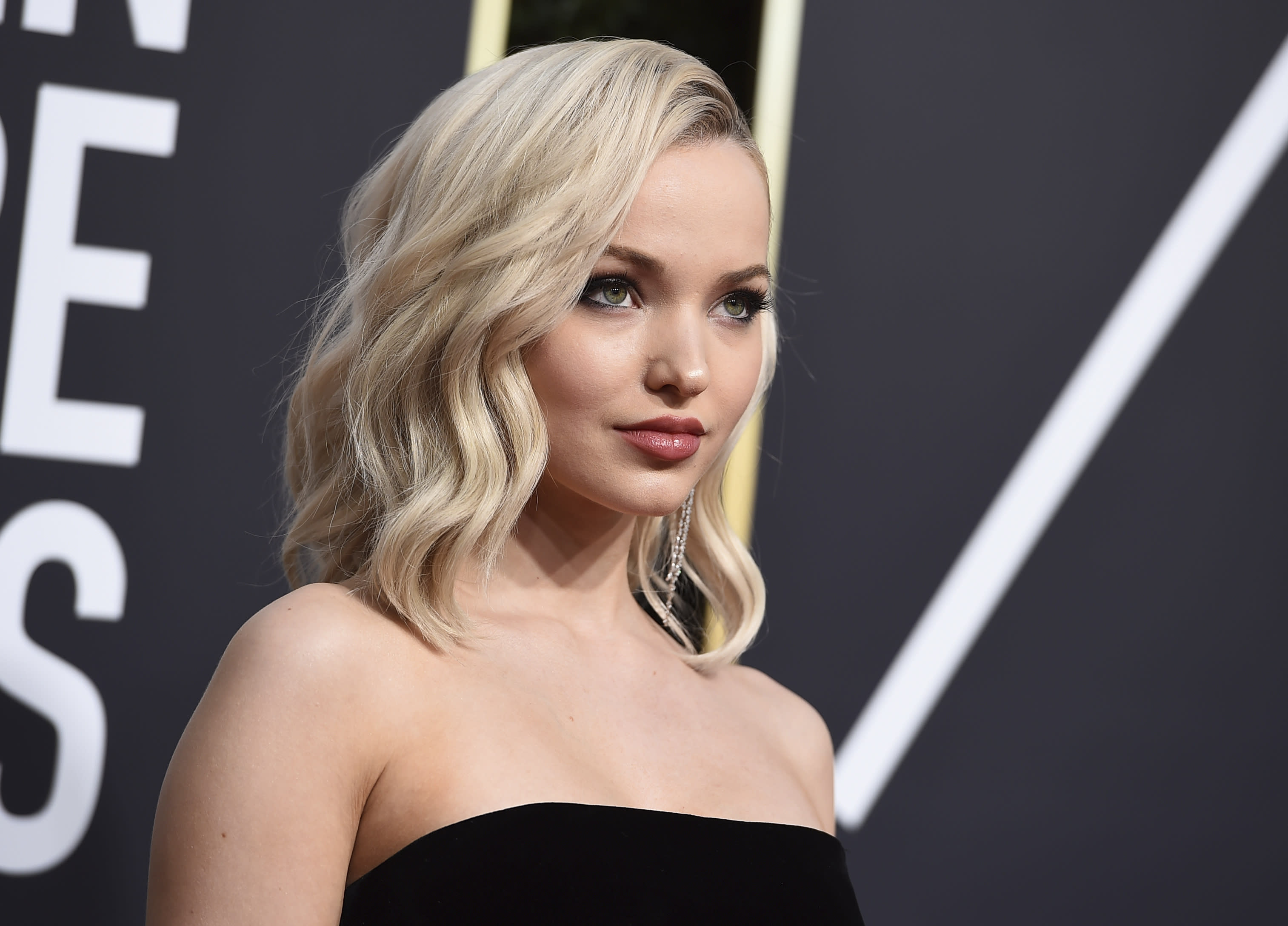 Dove Cameron arrives at the 75th annual Golden Globe Awards at the Beverly Hilton Hotel on Sunday, Jan. 7, 2018, in Beverly Hills, Calif. (Photo by Jordan Strauss/Invision/AP)