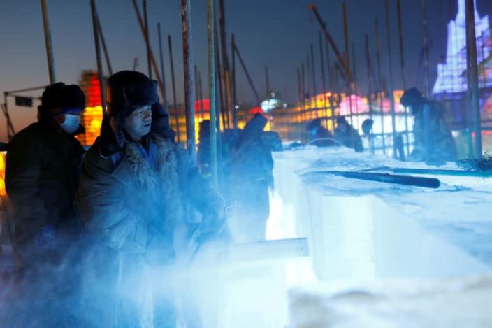 The Wider Image: China's ice sculptors build frozen castles in the cold