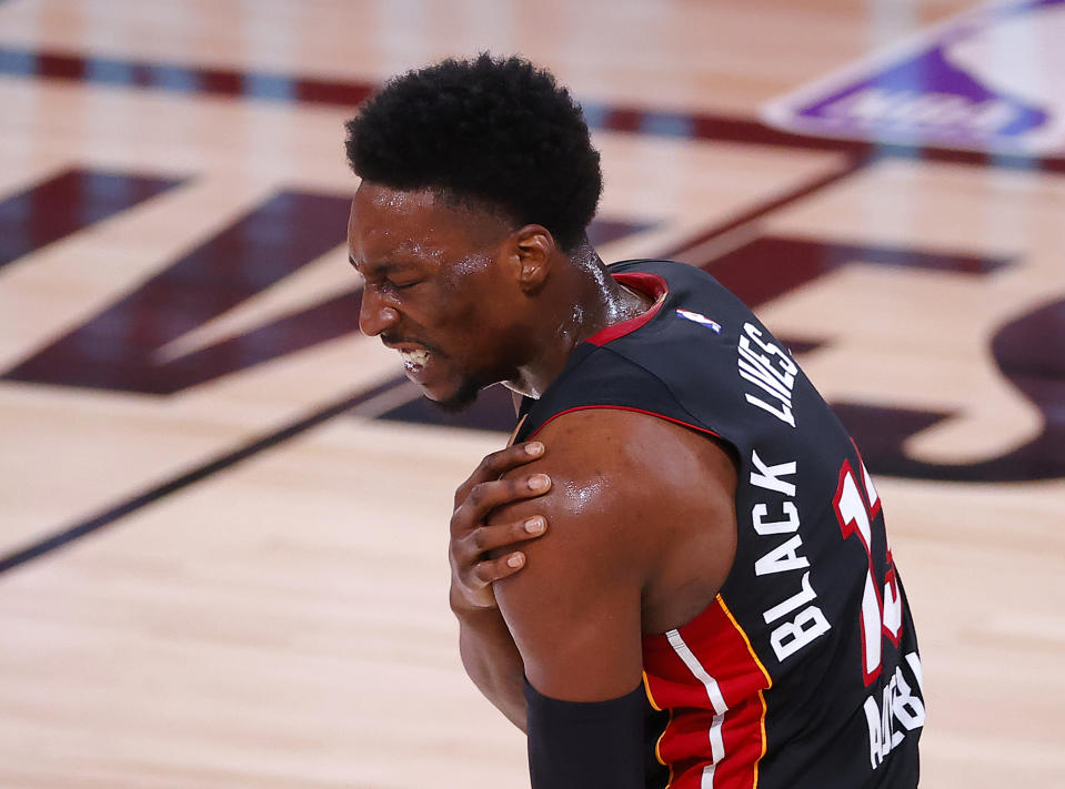 Bam Adebayo #13 of the Miami Heat reacts after being fouled during the first quarter against the Boston Celtics in Game Three of the Eastern Conference Finals during the 2020 NBA Playoffs at AdventHealth Arena at the ESPN Wide World Of Sports Complex on September 19, 2020 in Lake Buena Vista, Florida. NOTE TO USER: User expressly acknowledges and agrees that, by downloading and or using this photograph, User is consenting to the terms and conditions of the Getty Images License Agreement.  (Photo by Kevin C. Cox/Getty Images)