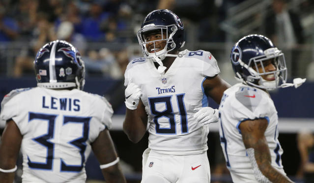Tennessee Titans tight end Jonnu Smith (81) celebrates his touchdown with his team during the second half of an NFL football game against the Dallas Cowboys, Monday, Nov. 5, 2018, in Arlington, Texas. (AP Photo/Michael Ainsworth)