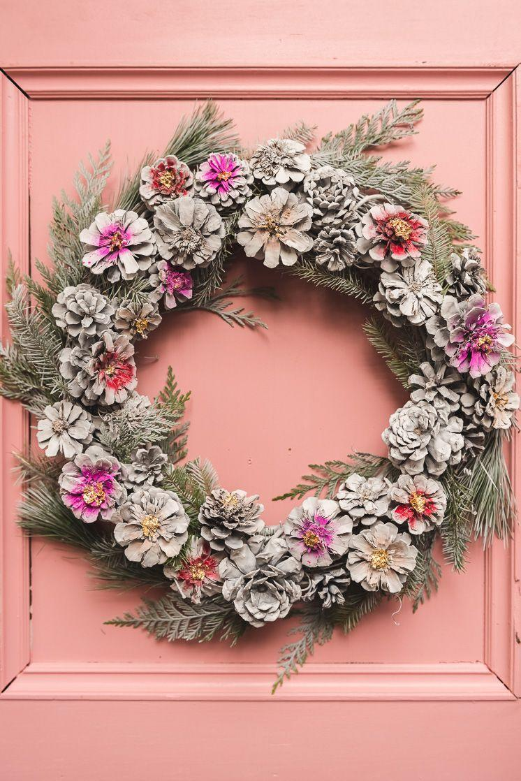 """<p>Simple organic materials — even found objects — can impart major drama on a Christmas porch. Try rendering them in unexpected ways with paint or other accessories, as in this pinecone wreath in an almost spring-like palette. <br></p><p><strong><em>Get the how-to at <a href=""""https://thehousethatlarsbuilt.com/2018/12/painted-pinecone-wreath.html/"""" rel=""""nofollow noopener"""" target=""""_blank"""" data-ylk=""""slk:The House That Lars Built"""" class=""""link rapid-noclick-resp"""">The House That Lars Built</a>.</em></strong> </p>"""