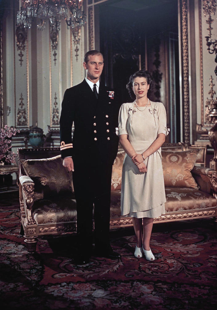 FILE - In this Sept. 1947 file photo, Princess Elizabeth and Lt. Philip Mountbatten pose for a photo in London. Buckingham Palace officials say Prince Philip, the husband of Queen Elizabeth II, has died, it was announced on Friday, April 9, 2021. He was 99. Philip spent a month in hospital earlier this year before being released on March 16 to return to Windsor Castle. Philip, also known as the Duke of Edinburgh, married Elizabeth in 1947 and was the longest-serving consort in British history. (AP Photo, File)