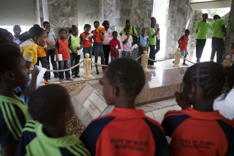 In this Friday, Nov. 23, 2012 photo, schoolchildren from the Hope of Glory Montessori school visit the Kwame Nkrumah Mausoleum and Memorial Park in Ghana, Accra. Nkrumah was the first leader of independent Ghana and a touchstone figure in modern African history. (AP Photo/Gabriela Barnuevo)