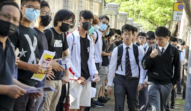 La Salle College students and alumni take part in a small protest outside the school. Photo: Dickson Lee