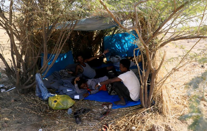 Ethiopians who fled war in Tigray region, rest inside a makeshift shelter with their belongings at the Um-Rakoba camp on the Sudan-Ethiopia border in Al-Qadarif state