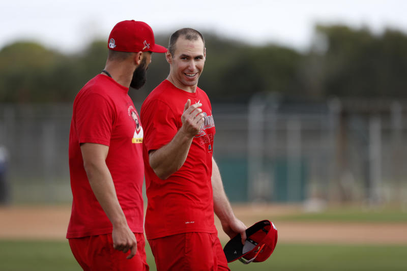 St. Louis Cardinals' Paul Goldschmidt, right, talks with teammate Matt Carpenter during spring training baseball practice Wednesday, Feb. 12, 2020, in Jupiter, Fla. (AP Photo/Jeff Roberson)