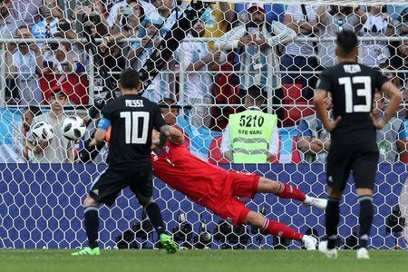 FILE PHOTO: Soccer Football - World Cup - Group D - Argentina vs Iceland - Spartak Stadium, Moscow, Russia - June 16, 2018 Argentina's Lionel Messi has a penalty saved by Iceland's Hannes Por Halldorsson REUTERS/Albert Gea/File Photo
