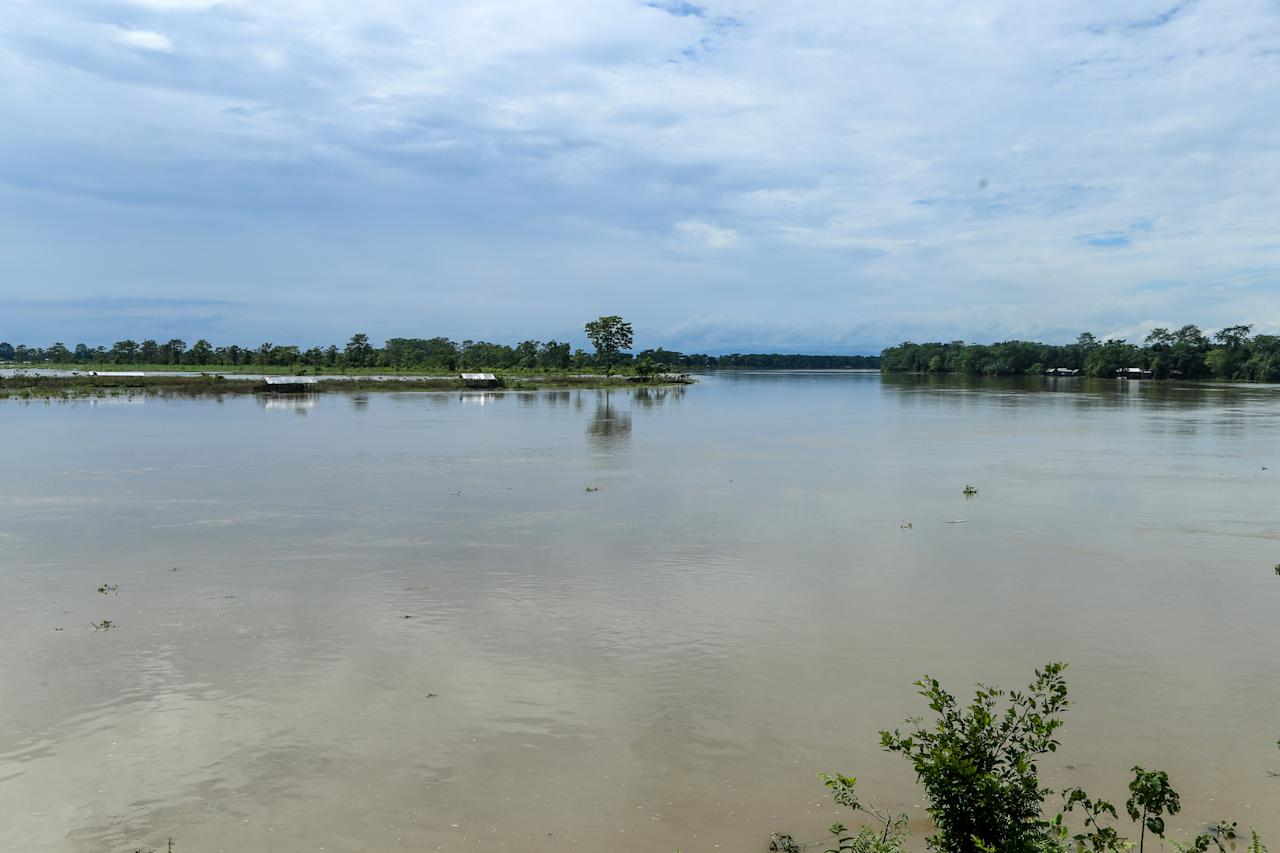 Water level of Dihing river raises and affects almost 30-40 families living in Laibil village, district of Assam, India, on July 22, 2020. (Photo by Dimpy Gogoi/NurPhoto via Getty Images)